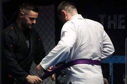 John McCormack during his Brazilian Jiu-Jitsu Training getting ready to spar with his coach.