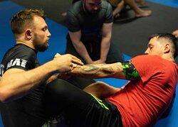 John having a spar with one of his students during his Brazilian jiu-jitsu class.