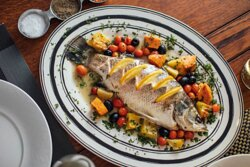 Baked Seabass with Lemon, Cherry Tomatoes Olives & Potatoes