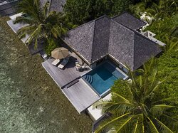 Aerial view of Ocean Pool Bungalow with sun-loungers on deck and swimming pool