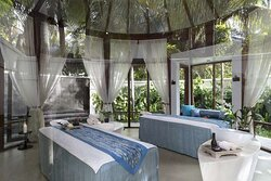 Interior view of treatment room in Anantara Balance Wellness Spa with garden view