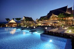 Pool and hotel building at night