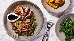 Whole roasted quail, boned and filled with herb risotto, wrapped in speck, on a parmesan and white bean puree paired with chargrilled corn and broccolini and green beans