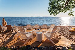 Fire table and lounge deck at the beach for guests