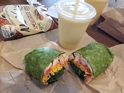 Southwest chicken in spinach wrap has a kick- Colada smoothie makes a nice calm match. Ranch chicken in honey wheat wrap. Pineapple Express delivers on the pineapple. Cute trendy decor.