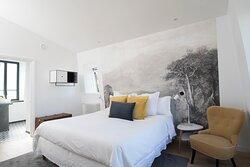 Chambre jaune avec lit King Size