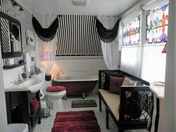 The (private) BOUDOIR bath features a clawfoot soaking tub, mood lights, bath salts and spa music.