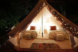 A tent set up with two twin xl beds