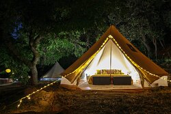a tent with a king sized bed