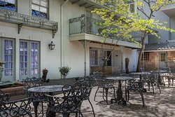 The courtyard at our Garden Bungalows has a collection of outdoor seating to enjoy with you family and friends.