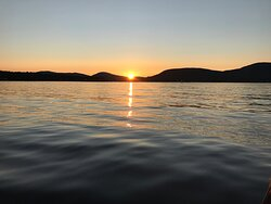 Setting sun over the Mountains of Maine