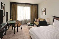 King bed, window and work station in Avani Room at Avani Deira Dubai