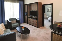 Living area with dining table in Avani Executive Suite
