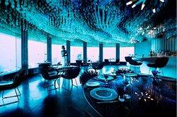 A woman enjoys stunning marine views at Subsix underwater restaurant.