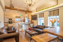 1st floor communal area for relaxing after a day of activity in the Lakes. Comfortable sofas, large fully equipped kitchen, and dining area
