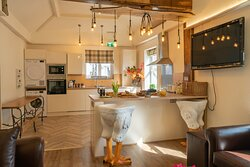 Bright Lounge Kitchen area with television to relax as you prepare a meal or plan which local eatery to visit