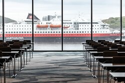Hurtigruten - The Norwegian Coastal Express passes by the hotel