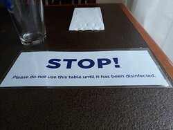 IF guests were to turn the DISINFECTED sign over when they're done with the table, it would keep everyone safer and move things along more quickly.