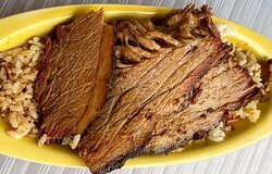 Sliced Brisket over rice and gravy - plate lunch comes with your choice of two sides.