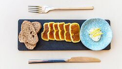 Greek grey mullet bottarga with rye bread and flavored butter