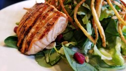 Grilled Salmon on mixed spinach and Boston lettuce salad at Grand Street Cafe, 4740 Grand Ave Ste 110, Kansas City, MO
