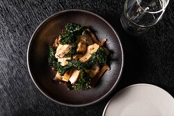 Grilled chicken with marinated mushrooms and crispy kale