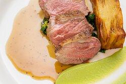 Seared lamb rump, potato terrine, minted pea puree, spring greens, jus