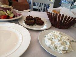 Zucchini patties, tzatziki and Greek salad with feta cheese