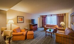 Suites feature a living area and wet bar