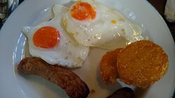 Breakfast of congealed, eggs and dried sausage. Bacon was gelatinous, barely booked and pale so went without. Eggs were like this everyday. Note: It was not buffet style. I didn't put this on my plate, you are served from behind a screen. It was all this awful.