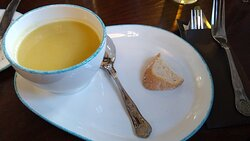 """""""Seasonal Soup with sourdough and butter"""". That's it! The small nub end of bread was rock hard, stale and no butter."""