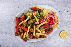 Tandoori Mixed Grill Platter,  this platter boasts with an authentic array of Indian flavours with Chicken Tikka , Lamb Seekh Kebab, Reshmi Kabab and Hara chicken tikka served with French Fries and our signature sauces at Curry Pot, Indian Restaurant, Al Ain.