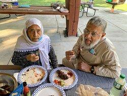 I and Sabiha enjoying the cooked items.