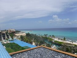 view from Artistas rooftop pool of the beach
