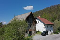 Front of the Guesthouse showing parking.   Secure parking for Motorcycles and Bicycles in the large secure barn.