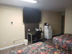 65-Inch Television in Handicap Accessible Double Bed Room