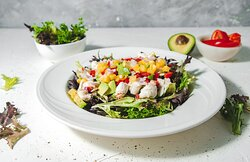 Crab meat, mango, avocado salad with red onions and red peppers, served on a bed of mixed greens, with champagne vinaigrette
