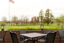 Camp Ti's patio overlooks Sylvan Glen Golf Course.