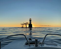 """Roman Rock Lighthouse as seen from our boat """"Sea Otter"""""""