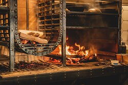 Wood fire grill centered in the heart of the kitchen