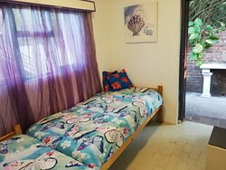 Tree Top has got a separate room with 2 single beds