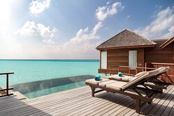 Over Water Pool Suite deck with loungers and lagoon view