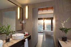 Over Water Suite bathroom with sunset view