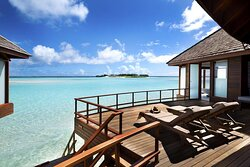 Over Water Suite deck with sunbeds and lagoon view