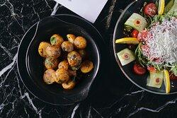 Baby potatoes and salad to accompany your main dish.