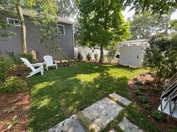 Unit 12 back yard with BBQ grill and outdoor shower