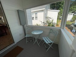 Unit 16 back screened porch w/ cafe table