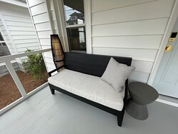 Unit 18 front screened porch soft seating and ambient lighting