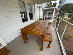 Unit 18 front screened porch dining table