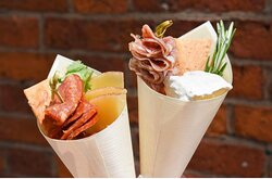 Just want a snack? Try one of our cones which includes, one meat, one cheese, a cracker and a side